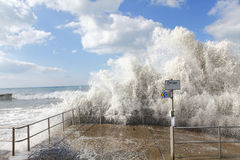 Storm wave. Huge storm ocean wave crashing over a coastal wall Stock Photo