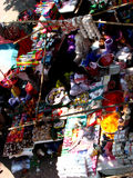 Huge Streetside Shop. A huge beautiful streetside shop under a tree selling all the things required to celebrate the Indian holi festival Royalty Free Stock Images