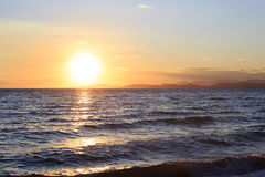 Huge sun sets in the Aegean Sea. Stock Image