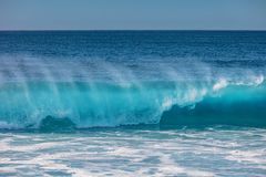 Huge surfing waves in ocean water. Blue ocean shorebreak wave for surfing sport activity. Template with nobody on background. Tropical summer scenery Royalty Free Stock Images