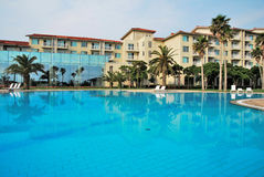 Huge swimming pool with luxurious resorts Stock Images