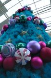 A huge tall blue christmas tree on display. A photo taken on a large tall blue christmas tree with stars and baubles decoration on display Royalty Free Stock Photo