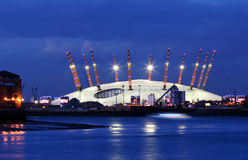 Huge tent in London. Huge tent at the bankside of the blue Thames in London at evening stock photography