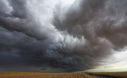 Huge thundercloud on fields Stock Photos