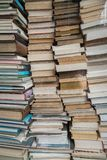 Huge tightly packed stack of assorted books royalty free stock photo