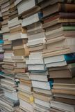 Huge tightly packed stack of assorted books Stock Photography