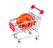 Huge tomato in shopping cart Stock Photography