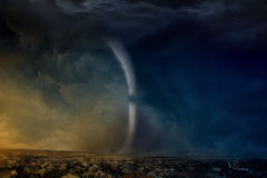 Huge tornado. Nature force background - huge tornado destroys small town, dark stormy sky Stock Photos
