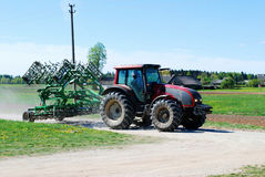 Huge tractor moving to the work in a nice blue sunny day Royalty Free Stock Images
