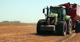 Huge tractor with tank, end of summer, rye stubble in the foreground. Prores, Slow Motion. 4k stock footage