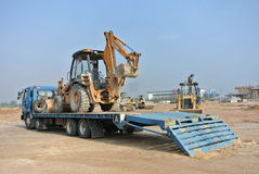Huge trailer lorry used to mobilize the excavator machine. SELANGOR, MALAYSIA – MAY 05, 2014: Huge trailer lorry used to mobilize the excavator machine Stock Image