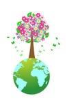 Huge tree on world globe Stock Photography