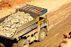 Huge trucks work in a quarry mining Stock Image