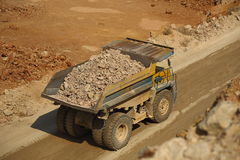 Huge trucks work in a quarry mining Royalty Free Stock Images