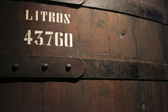 Huge tun containing Port wine. Detail of a huge tun containing Port wine. Close-up of the sign reporting 43.760 liters royalty free stock photos