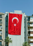 Huge Turkish flag hanging from a building in Turkey Royalty Free Stock Image