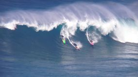 Huge turquoise blue foamy surfing waves splash as professional surfers ride perform stunts in amazing 4k ocean seascape. Huge turquoise blue foamy surfing waves stock video footage