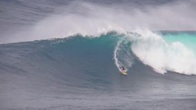 Huge turquoise blue foamy surfing waves splash as professional surfers ride perform stunts in gorgeous 4k ocean seascape. Huge turquoise blue foamy surfing waves stock footage