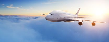 Huge two-storey passengers commercial airplane. Flying above clouds in sunset light. Concept of fast travel, holidays and business stock photos