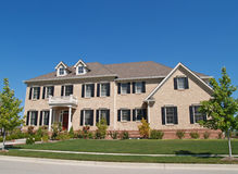 Huge Two Story Brick Home. With black shutters Stock Image