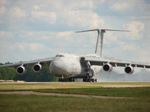Huge US Air Force Lockheed C5 Galaxy Landing. The photo of this huge US Air Force Lockheed C5 Galaxy was taken while landing in Oshkosh, WI Stock Photos