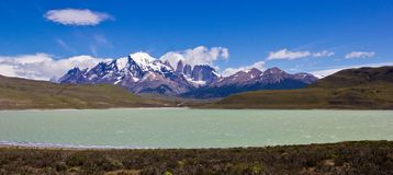 Huge valley and clear water lake in south america landscape stock image