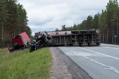 A huge wagon rolled over after an accident on the highway Scandinavia stock photos