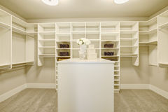 Huge walk-in closet with shelves, drawers and shoe racks. stock image