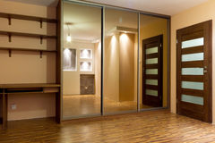 Huge wardrobe of modern apartment. Modern apartment interior with huge wardrobe Stock Photography