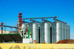 Huge warehouse facilities for agricultural sector. Under clear sky Stock Photos