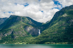 Huge waterfall in the fjord shores, Norway. Stock Photos