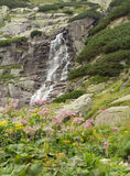 Huge waterfall in mountains Stock Image