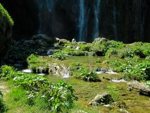 Huge waterfall with small cascades of water in the Plitvice lakes national Park in Croatia royalty free stock images