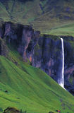 Huge waterfall and small red house Royalty Free Stock Image