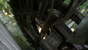 Huge watermill on water turning around stock video