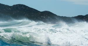 Huge wave on the blue sea stock photos