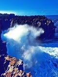 Huge wave breaks on rock. Digital illustration of huge ocean power. Stock Images