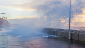 Huge wave breaks and splashes Royalty Free Stock Image