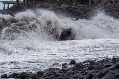 Huge wave on the coastline of Madeira island. Huge wave breaking on the coastline of Portuguese island of Madeira royalty free stock photos
