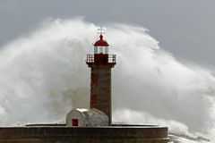 Huge wave over lighthouse Royalty Free Stock Photography
