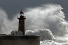 Huge wave over lighthouse Stock Photo