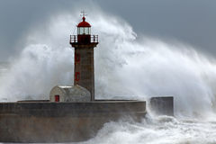 Huge wave over lighthouse Stock Images