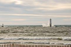 Huge Wave Crashes Into Lighthouse Royalty Free Stock Image