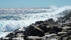 Huge waves break on the coastal cliffs. Of the Italian Riviera. Slow motion stock video