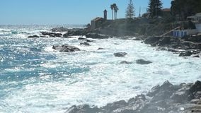 Huge waves break on the coastal cliffs stock video footage