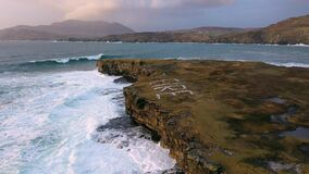 Huge waves breaking at Muckross Head - A small peninsula west of Killybegs, County Donegal, Ireland. The cliff rocks are