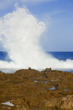 Huge Waves Crashing. Large white waves crash together along the north shore of oahu hawaii during the daytime Royalty Free Stock Photo