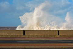 Huge waves crashing onto promenade Royalty Free Stock Image