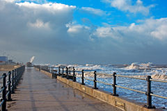 Huge waves crashing onto promenade Stock Photos