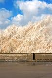 Huge waves crashing onto promenade Stock Image